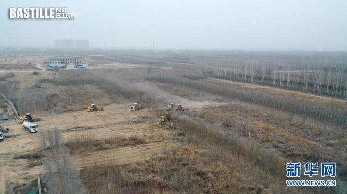 1月13日,中鐵十四局集團工人在施工現場作業(無人機照片)。