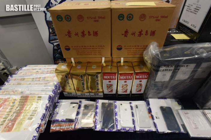 警方破盜用信用卡買名酒轉售集團 拘4人檢30萬現金