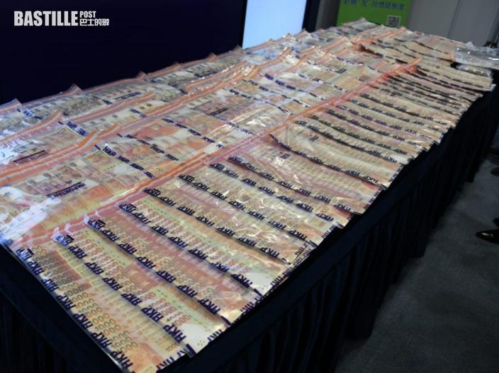 警瓦解「唱高散貨」造市集團 拘12人檢獲逾9億財物