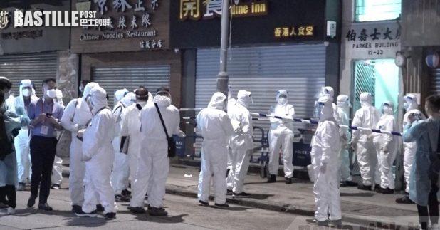 當局昨晚圍封患者居住的伯嘉士大廈,約80名居民接受病毒檢測。(施華駿攝)
