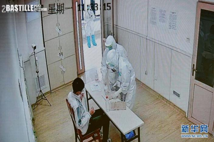 6月7日,廣東省國家教育考試指揮中心的監控畫面顯示,上午語文考試結束後,廣州市八醫院嘉禾院區醫護人員對隔離病房考生的試卷、答題卡、稿紙等用品進行消毒。新華社記者 劉大偉 攝