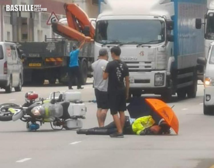 粉嶺的士撞交警電單車 鐵騎警受傷送院